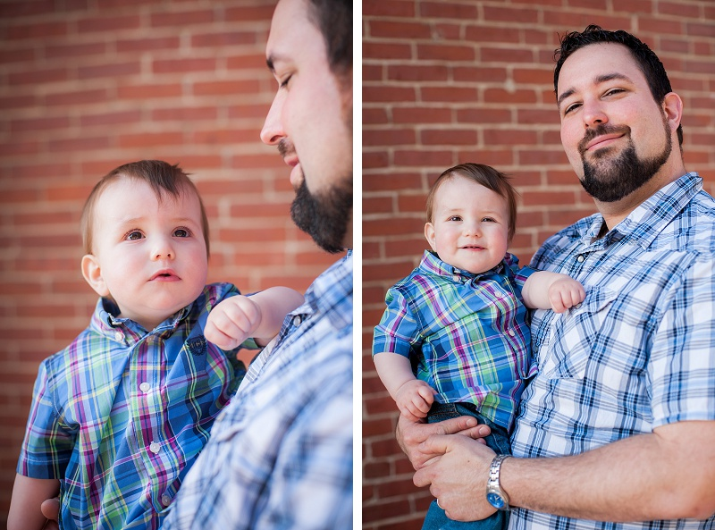 Father holding son wearing plaid