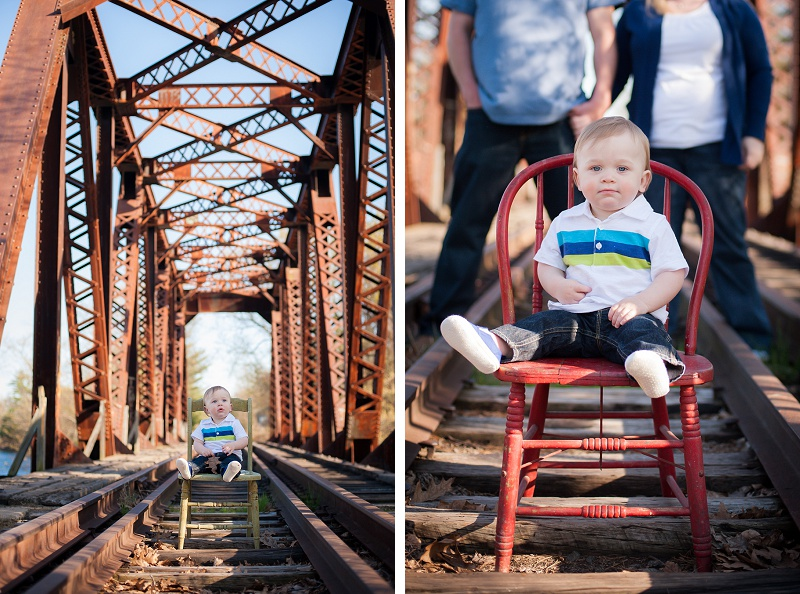 Boy sitting on vintage chair on rustic train tracks