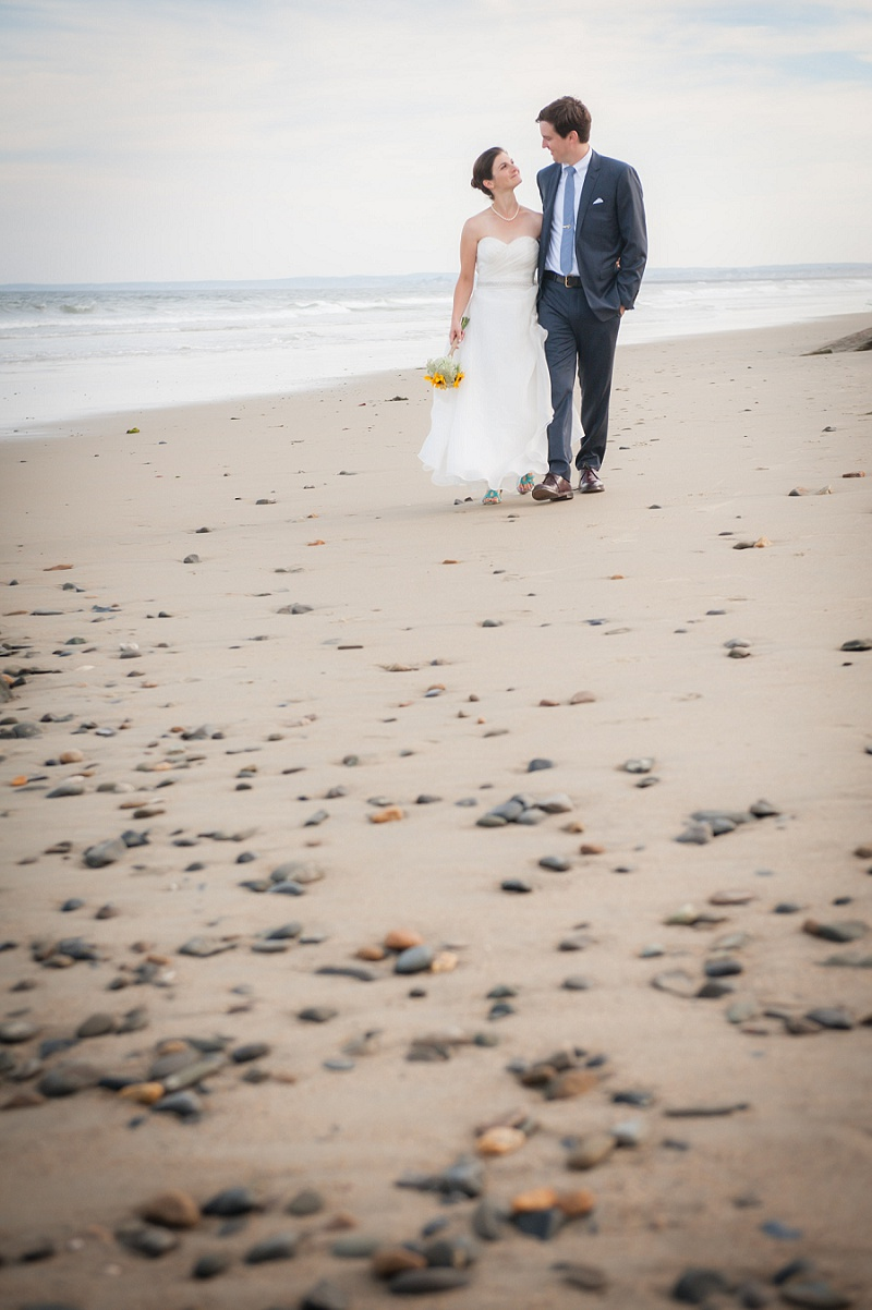 Bride and groom walking on the beach at Wells Reserve