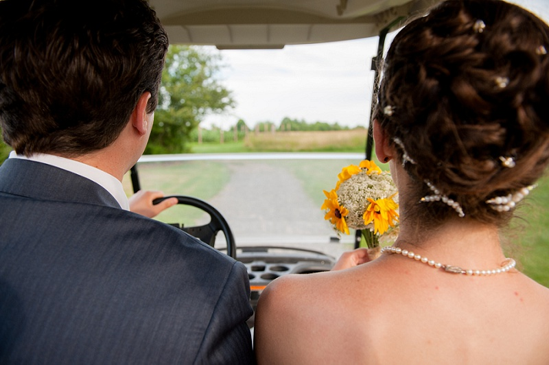 Newlyweds in a golf cart