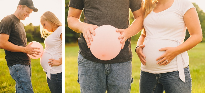 Father holding balloon next to pregnant mother's belly