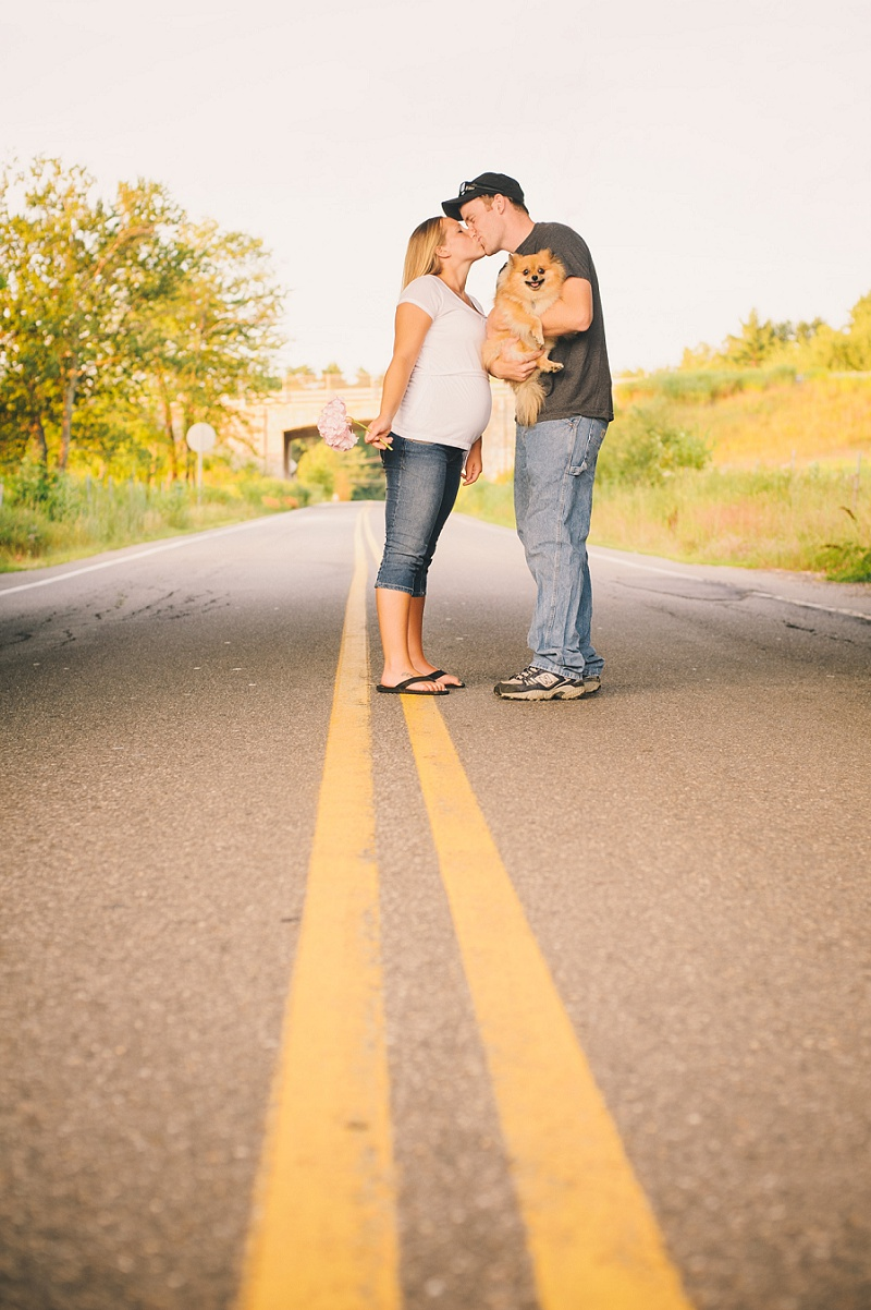 Parents to be kissing in the middle of the road