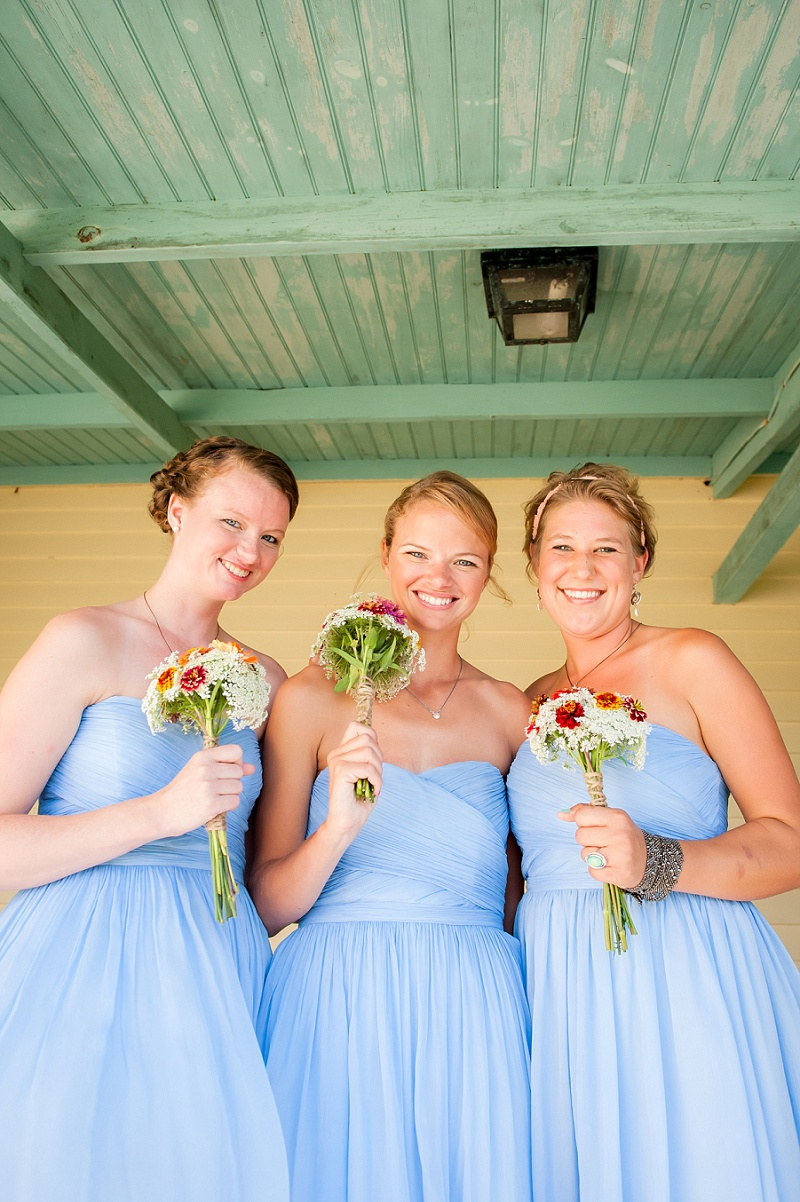 Beautiful smiling bridesmaids on the Farm House porch at Wells Reserve