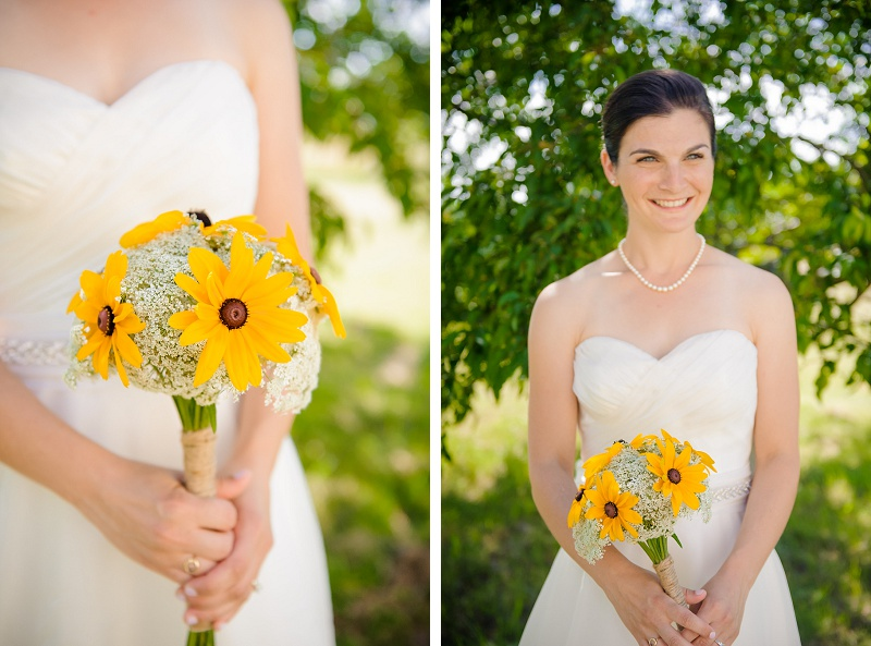Beautiful smiling bride holding her bouquet of black eyed susans at Wells Reserve