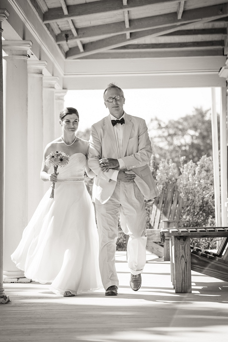 Bride and father walk down the aisle at Wells Reserve black and white