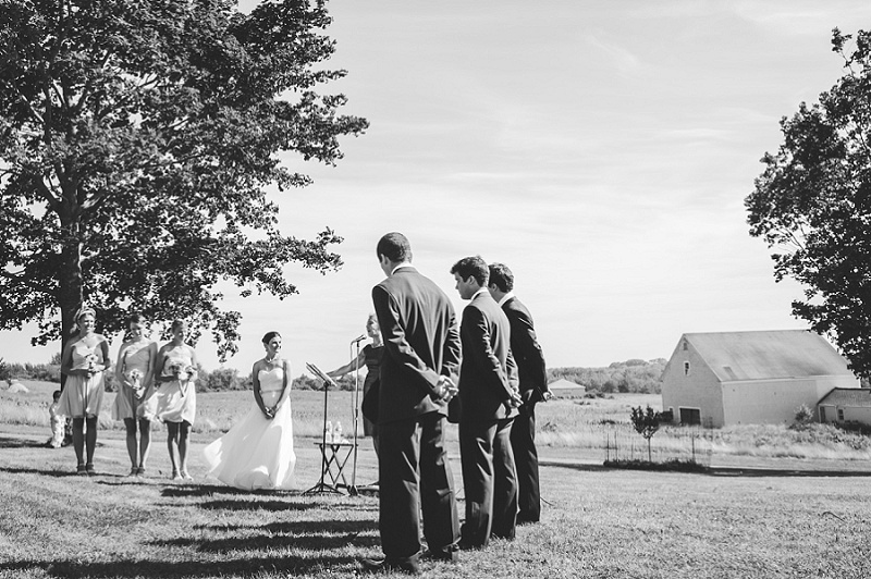 Wedding party during ceremony at Wells Reserve black and white