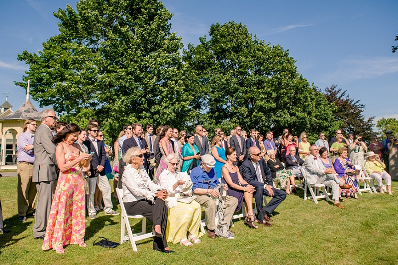 Wedding guests during ceremony at Wells Reserve
