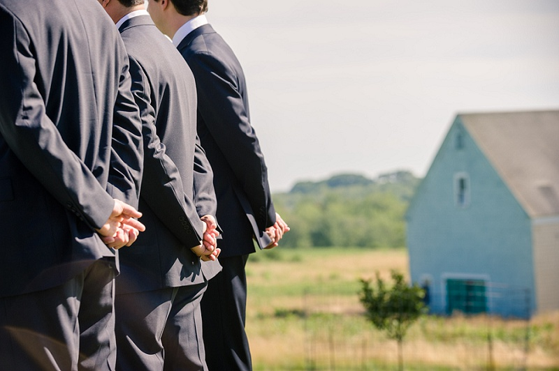Groomsmen folding hands behind their back wedding Wells Reserve