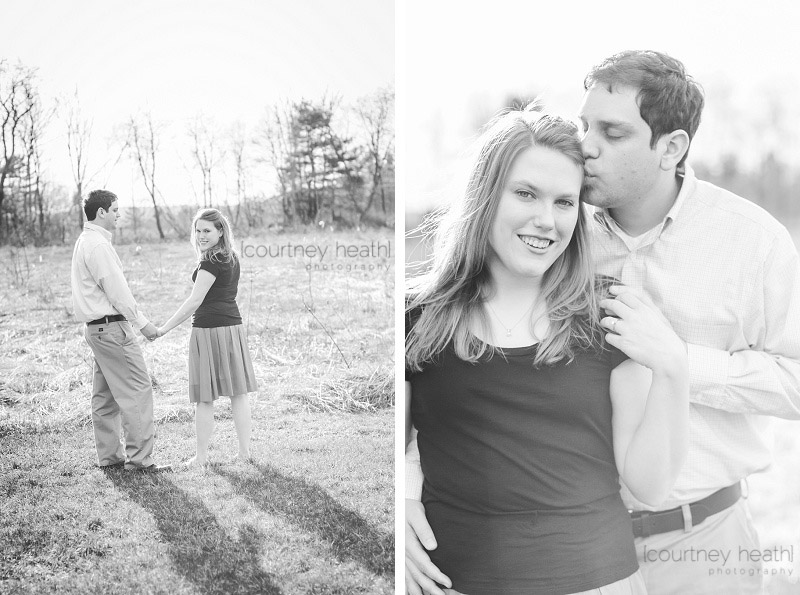 Man kissing woman's head black and white engagement photo