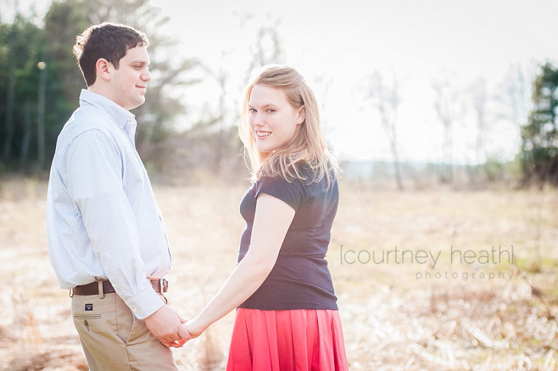 Spring engagement photos in a field