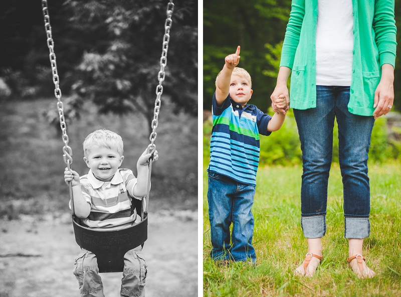 Young boy swings and holds his mother's hand while pointing at the sky