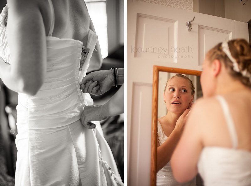 Bride wearing wedding dress and putting on jewelry