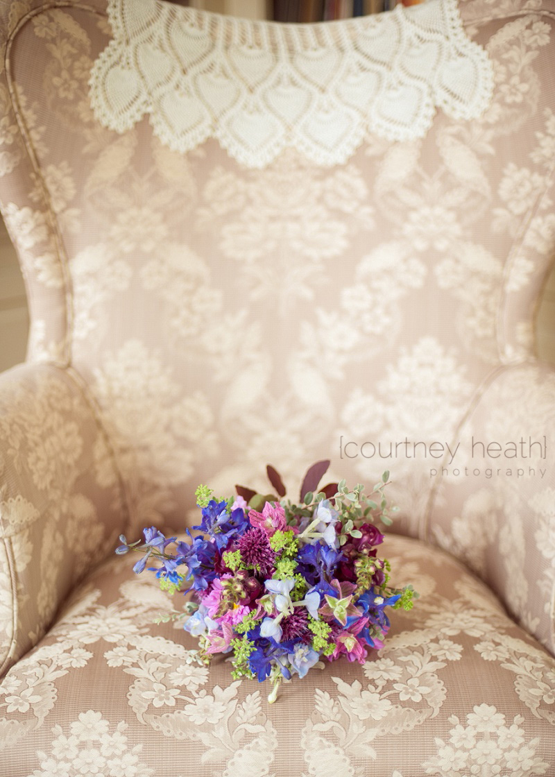 Colorful country bouquet on upholstered chair