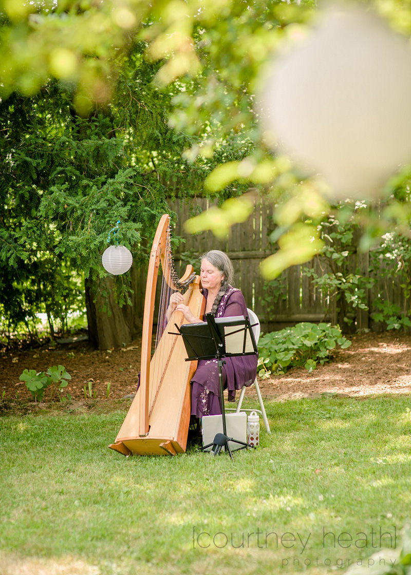 Harpist Playing before wedding ceremony at the Inn at Valley Farms