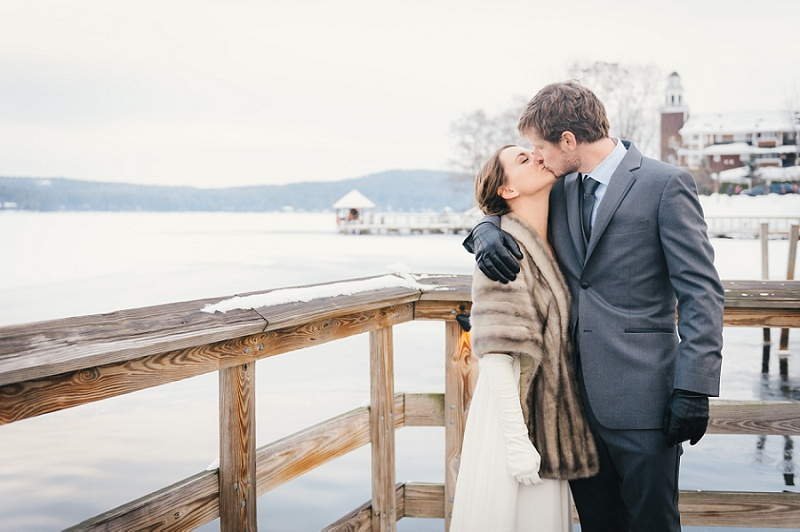 Bride and groom kissing at Meredith Town Docks