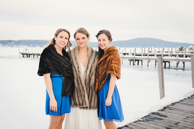 Bride and bridesmaids wearing fur stoles at Meredith Town Docks