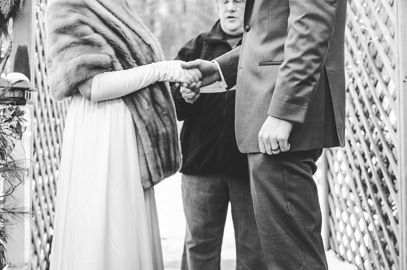 Bride and Groom holding hands during winter wedding ceremony Meredith NH