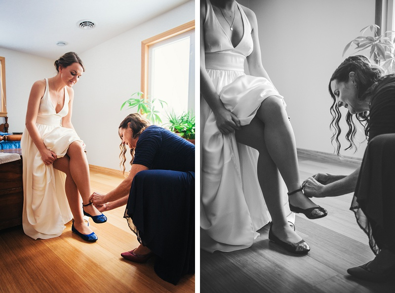 Bride's mother helping bride with her wedding shoes