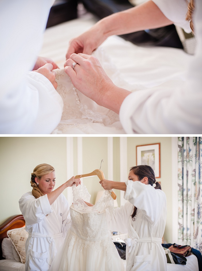 bride and bridesmaid preparing wedding dress at Mount Washington Hotel