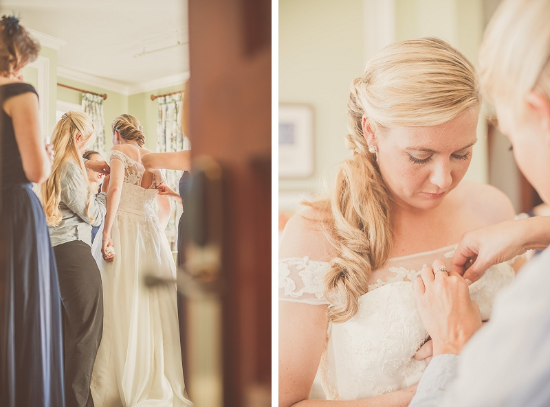 Bride getting dressed at Mount Washington Hotel