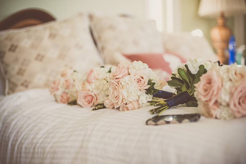 wedding flowers on bed at Mount Washington Hotel