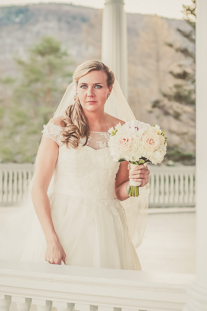 Beautiful bride with stunning eyes on the porch at Mount Washington Hotel in Winter