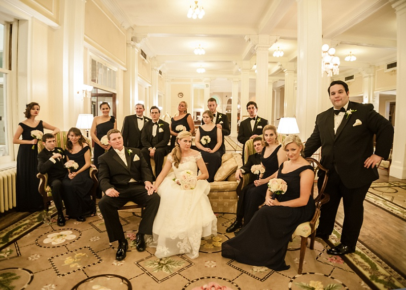 Winter wedding party posing vogue an lobby of Mount Washington Hotel