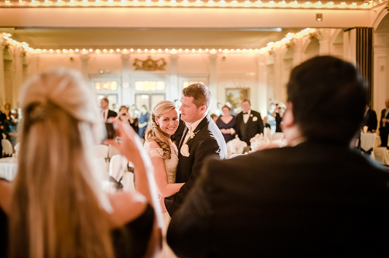 Bride and Groom smiling during first dance at wedding reception at Mount Washington Hotel Ballroom