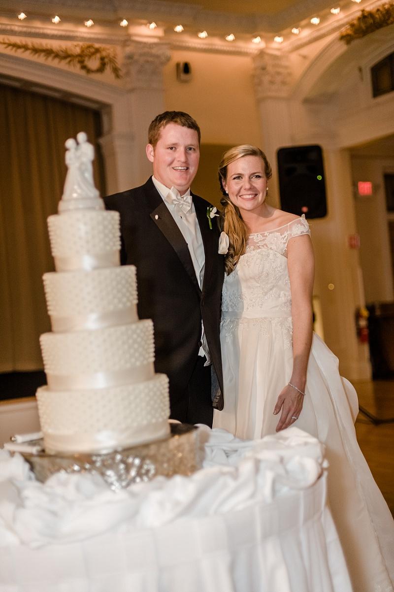Smiling Bride and Groom next to Wedding Cake Mount Washington Hotel