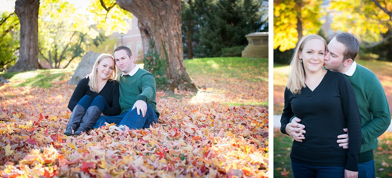 Engaged couple sitting in colorful fall leaves on UNH campus