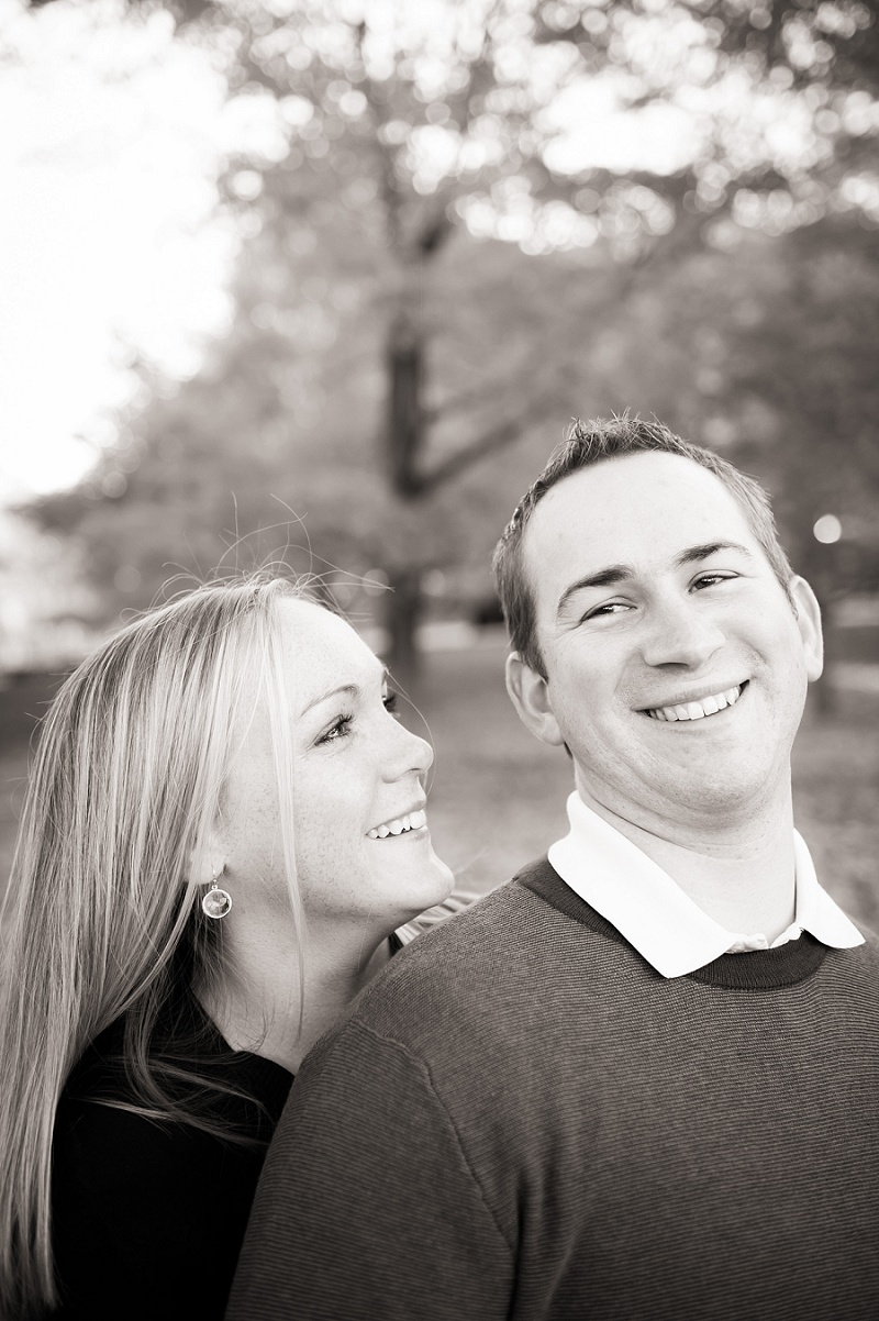 Engaged couple laughing black and white