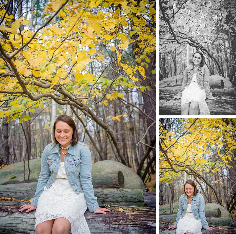 Girl sitting on a log under yellow leaves giggling