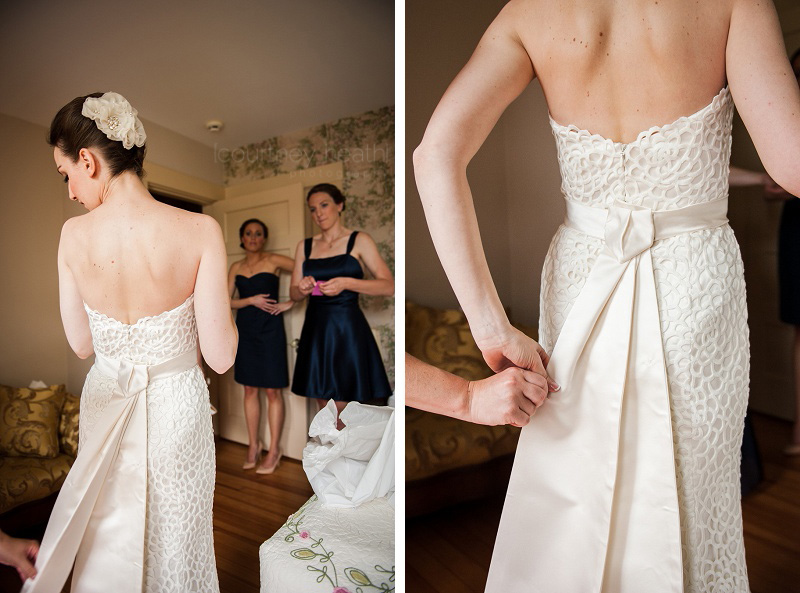 Bridesmaid adjusting bride's wedding dress