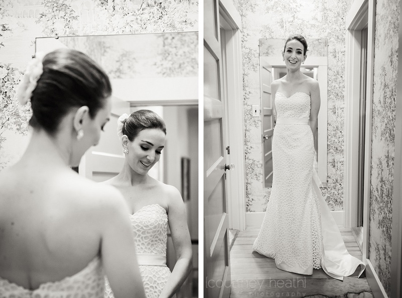 Bride smiling in front of mirror
