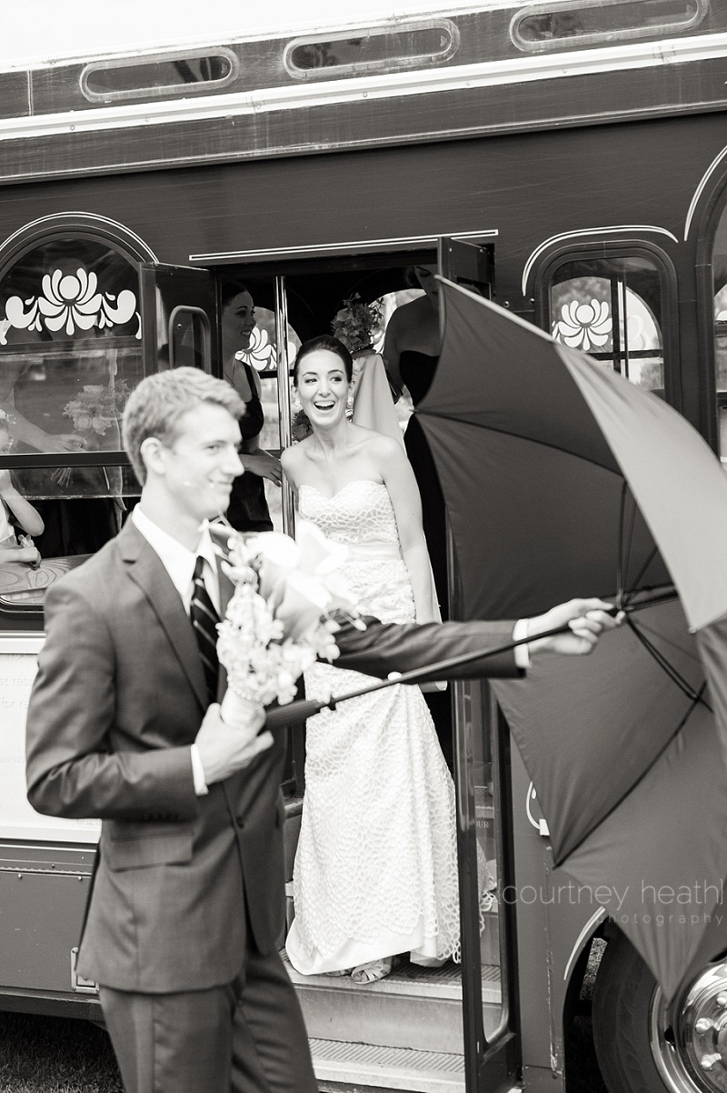 Black and white bride laughing while stepping off of trolley