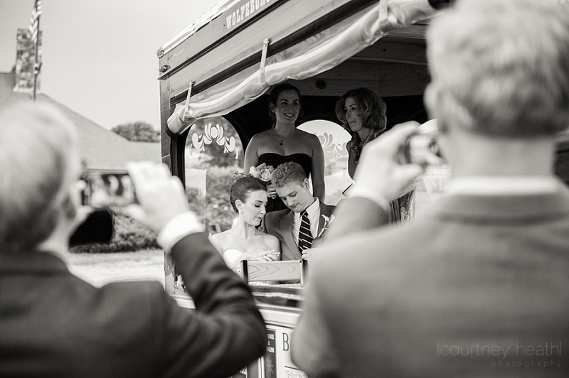 Guests take a picture of bride and groom