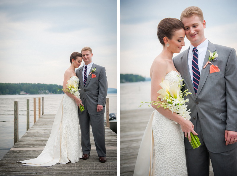Bride and groom pose on Wolfeboro Town Docks