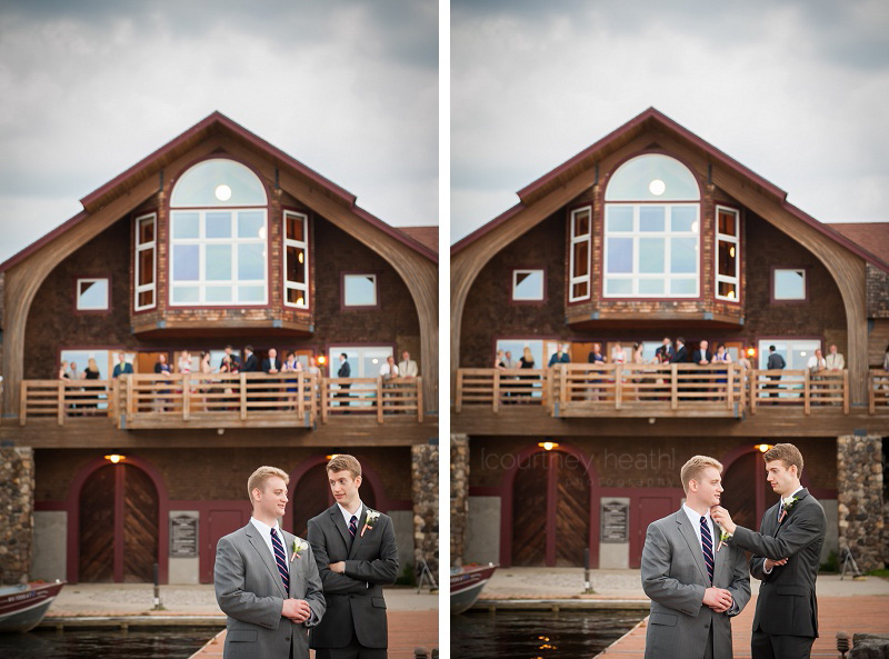 Groom and best man in front of boat house at Brewster Academy