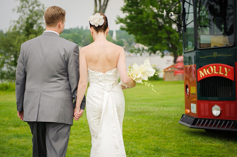 Groom and bride walk to trolley holding hands