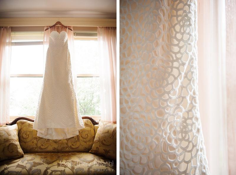 Beautiful unique wedding dress hanging in a window