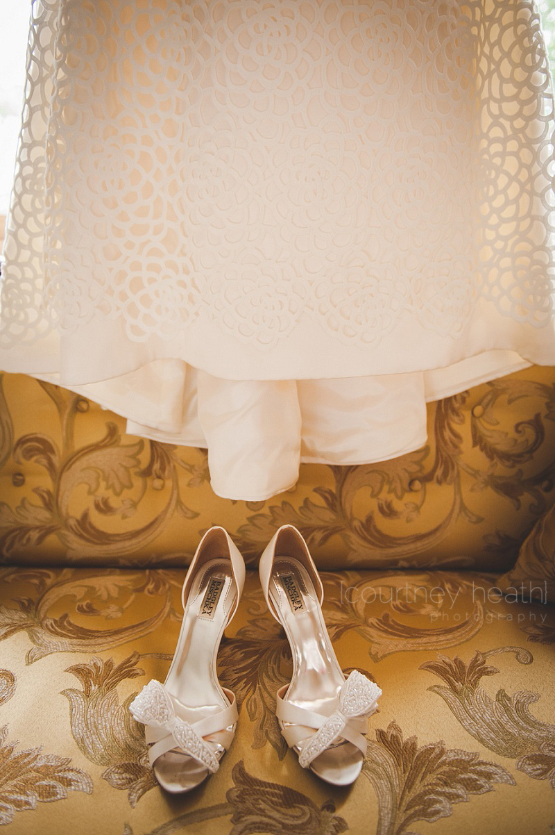 bride shoes under wedding dress on vintage couch