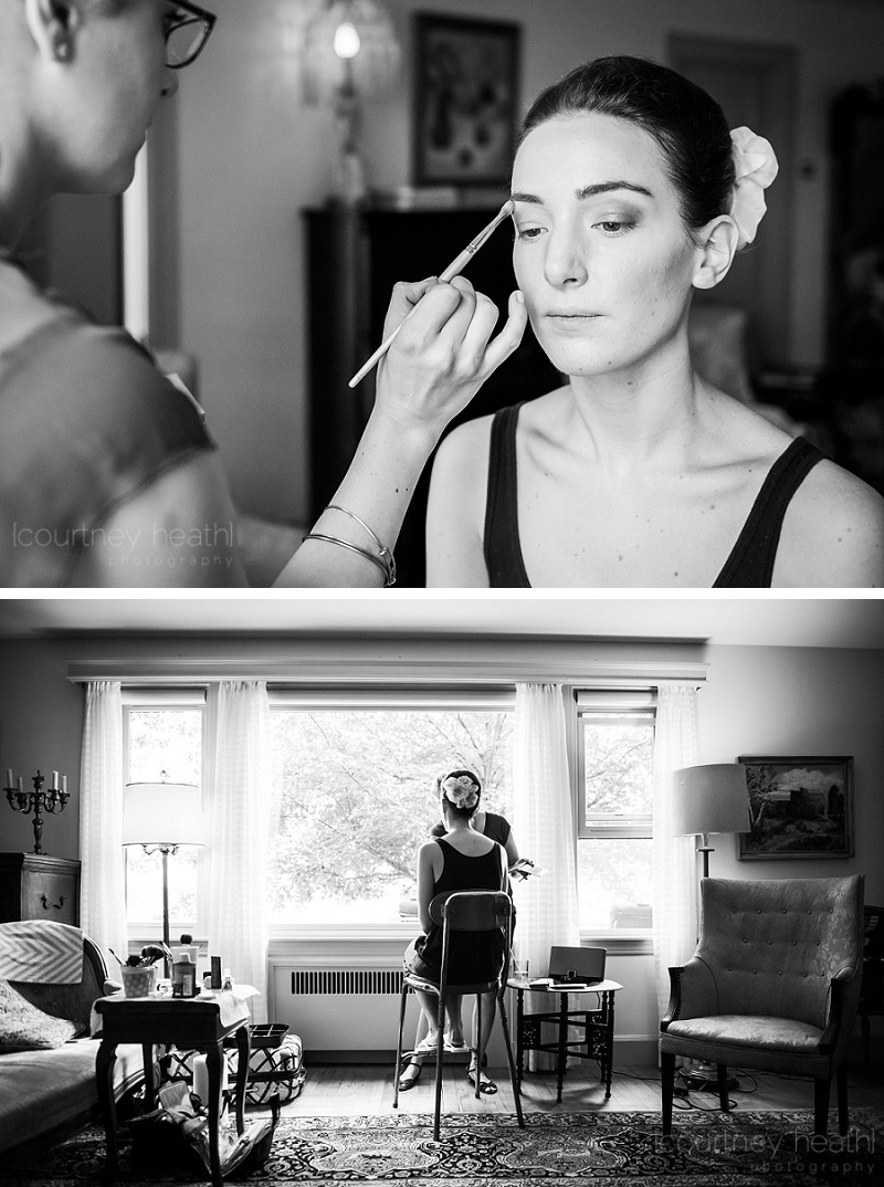 Bride getting her makeup done near a window