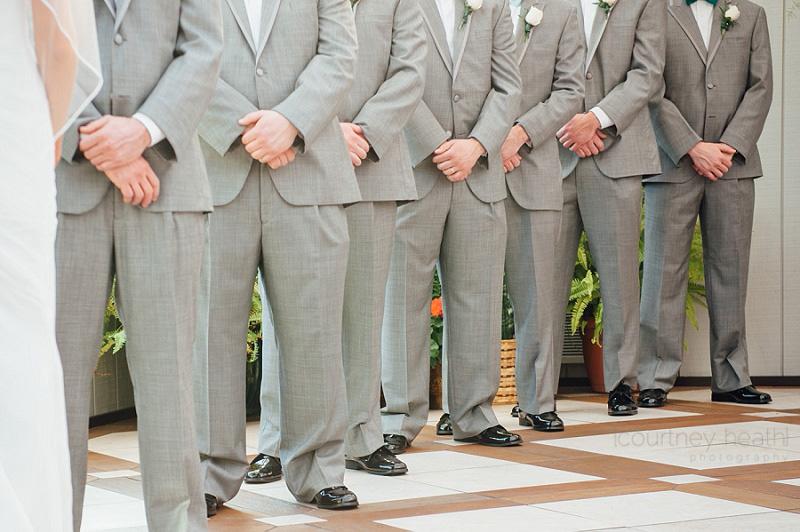 Groomsmen during wedding ceremony Farmington Gardens