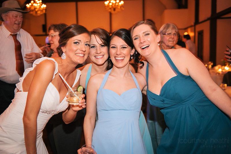 Candid bride with bridesmaids at wedding reception