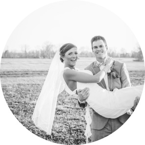 Groom holding bride black and white
