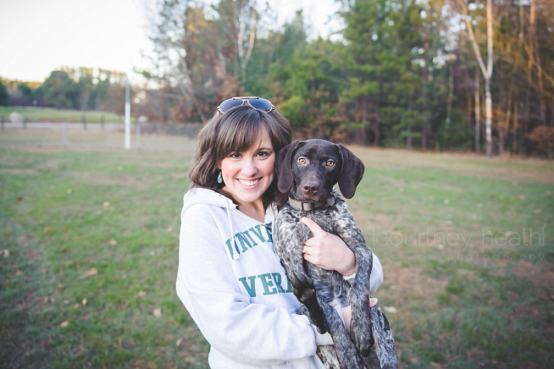 Girl holding German Shorthaired Pointer