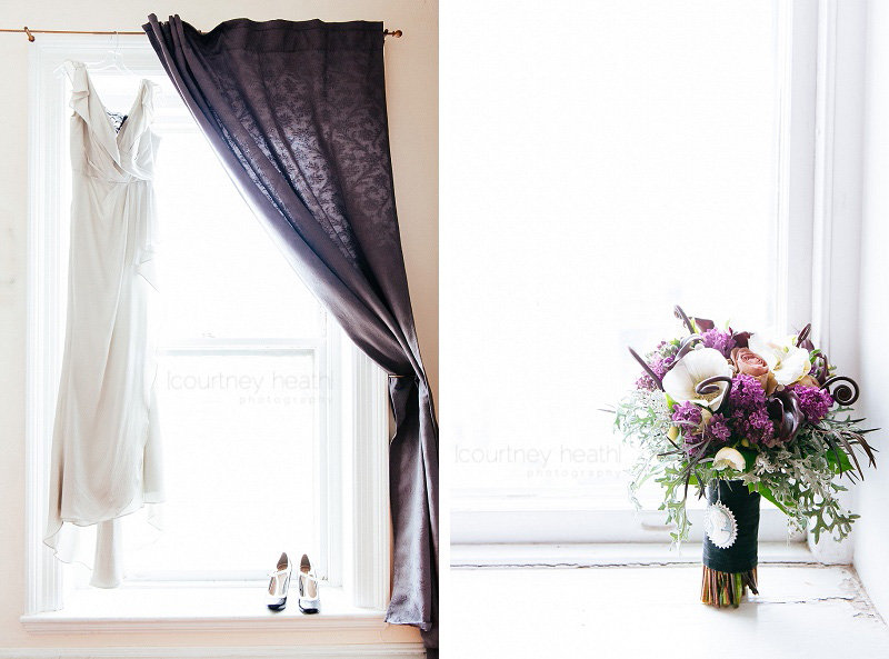 wedding dress, shoes, and bouquet in window