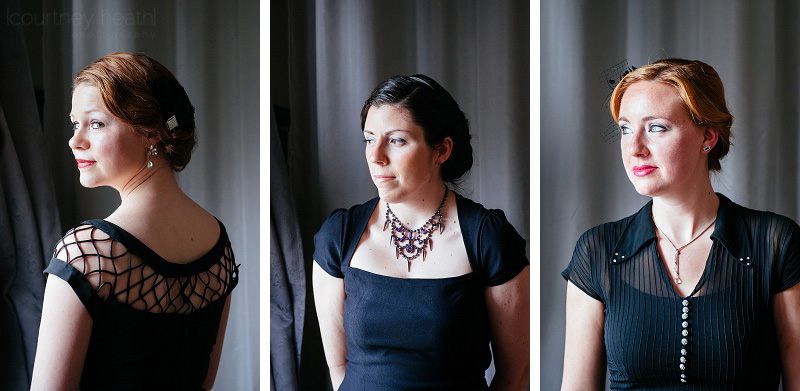 bridesmaids wearing black dresses posing next to window