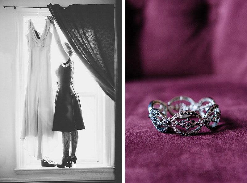 bridesmaid taking wedding dress down from hanging in the window