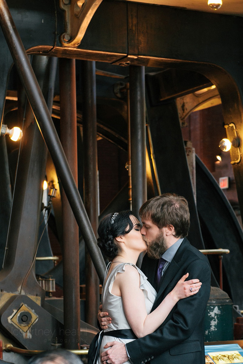 Bride and groom first kiss at Waterworks Museum